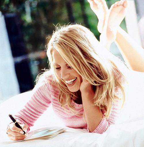 Happy woman writing